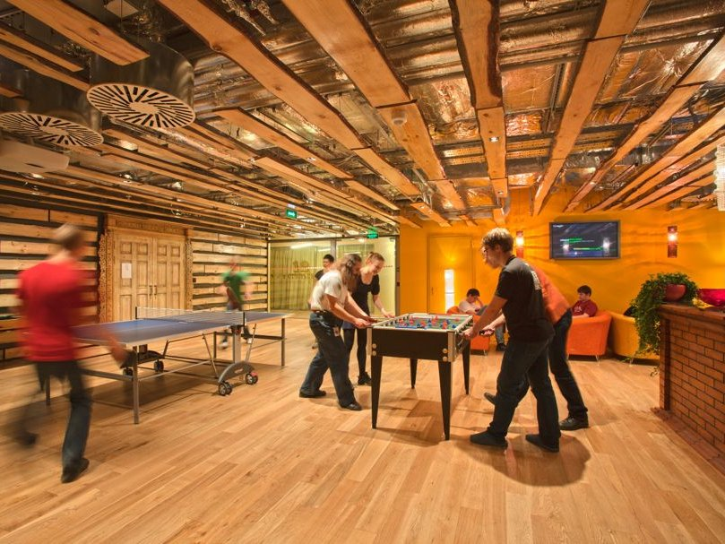 employees-in-moscow-can-play-table-tennis-and-foosball-inside-this-cozy-wood-paneled-room