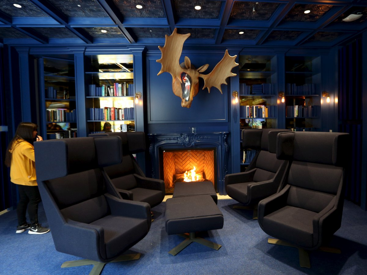 this-cool-modern-blue-library-in-ontario-is-full-of-books-and-its-own-fireplace