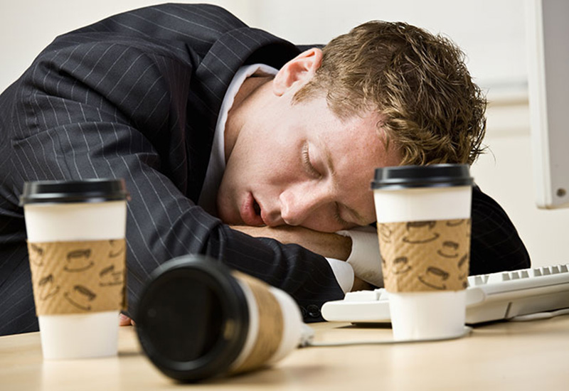 dehydated-employee-sleeping-at-work-fatigued-glass-of-water-cooler-delivery-free