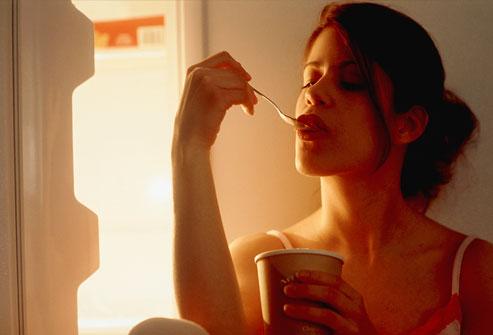 photolibrary_photo_of_woman_eating_ice_cream