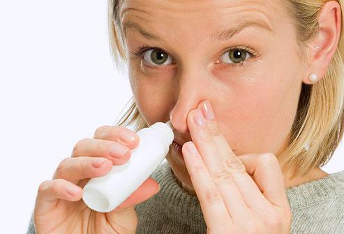 photolibrary_photo_of_woman_inhaling_nasal_spray