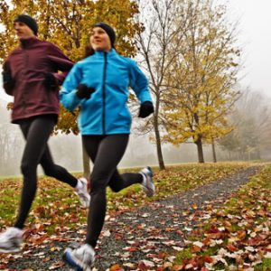 getty_rf_photo_of_couple_running_through_park