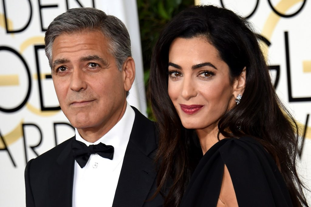 Actor George Clooney (L) and Amal Clooney arrive on the red carpet for the 72nd annual Golden Globe Awards, January 11, 2015 at the Beverly Hilton Hotel in Beverly Hills, California. AFP PHOTO/MARK RALSTONMARK RALSTON/AFP/Getty Images
