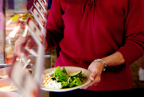 thinkstock_rf_photo_of_woman_at_salad_bar